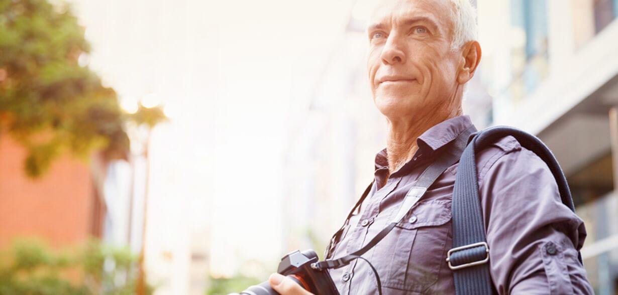 Man with camera around his neck
